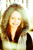 Pretty Teenager in Winter Coat. Beautiful teenage girl with captivating eyes royalty free stock image