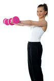 Pretty teenager working out with dumbbells Stock Photos