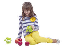 Pretty teengirl sitting with watering can and apples Royalty Free Stock Image