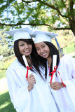 Pretty Teens at Graduation. Pretty young women at graduation with their diplomas Royalty Free Stock Images