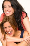 Pretty teens laughing and smiling at camera stock photo