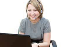 Pretty telephone operator. In an office stock images