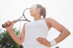 Pretty tennis player holding racket Stock Image