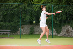 Pretty tennis player playing on court Stock Photo