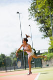 Pretty tennis player serving the ball Royalty Free Stock Photography