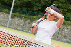 Pretty tennis player wiping her brow Stock Image