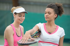 Pretty tennis players on court. Pretty tennis players on the court Stock Photo