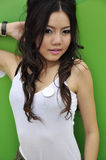 Pretty Thai girl with long hair and sleeveless top Royalty Free Stock Photos