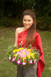 Pretty Thai woman hold flower joist. Pretty Thai woman in Thai style clothes in posing hold flower joist Royalty Free Stock Photo