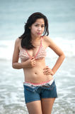 Pretty Thai woman  posing on the beach . Royalty Free Stock Photography