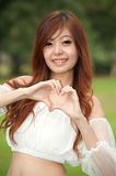 Pretty Thai woman posing on the lawn  . Royalty Free Stock Images