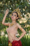 Pretty Thai woman posing in Thai ancient dress . Royalty Free Stock Photography