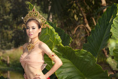 Pretty Thai woman posing in Thai ancient dress . Stock Images