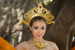 Pretty Thai woman posing in Thai ancient dress . Royalty Free Stock Photos