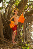 Pretty Thai woman posing in Thai ancient dress . Stock Photography