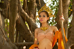 Pretty Thai woman posing in Thai ancient dress . Stock Image
