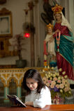 Pretty Thai woman study bible  . Royalty Free Stock Images