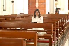 Pretty Thai woman study bible  . Royalty Free Stock Photos