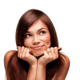 Pretty thinking woman. With beautiful smile isolated on white background Stock Images