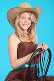 Pretty thirteen year old girls wearing a big floppy straw sun hat Stock Images