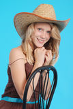 Pretty thirteen year old girls wearing a big floppy straw sun hat Stock Photography