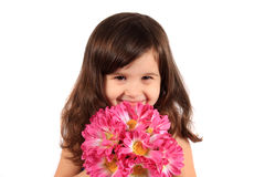 Pretty three year old girl with flowers Stock Photography