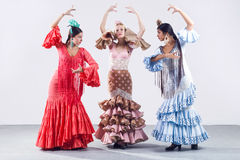 Pretty three young flamenco dancer in beautiful dress. Stock Photos