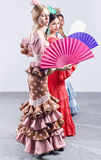 Pretty three young flamenco dancer in beautiful dress. Royalty Free Stock Photo