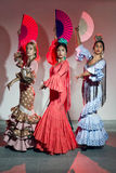 Pretty three young flamenco dancer in beautiful dress. Royalty Free Stock Photography