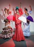 Pretty three young flamenco dancer in beautiful dress. Royalty Free Stock Photo