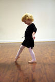 Pretty Toddler Ballerina. This little toddler girl ballerina is starting early learning her form Stock Images