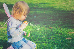 Pretty toddler girl with butterfly wings Royalty Free Stock Photo
