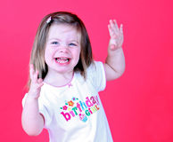 Pretty toddler girl dancing. On pink background Royalty Free Stock Photos