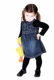 Pretty toddler girl with hand on hips. And stuffed animal showing attitude Royalty Free Stock Photography