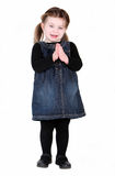 Pretty toddler girl with hands in prayer. On white background Stock Image