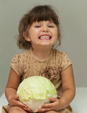 Pretty toddler girl holding cabbage and smiling Royalty Free Stock Photo