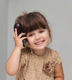 Pretty toddler girl holding eggplant and smiling Stock Photos