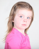 Pretty toddler girl portrait on white. Pretty toddler girl with attitude on white background Stock Photo