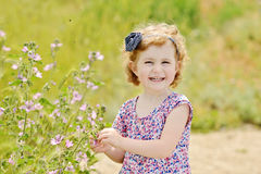 Pretty toddler girl in spring Stock Image