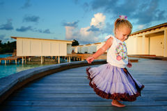 Pretty toddler girl in tutu skirt at sunset Stock Photography