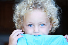 Pretty toddler portrait. A pretty young girl wigh gorgeous blue eyes and curly blonde hair Royalty Free Stock Image