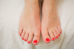 Pretty toes with red nail polish Royalty Free Stock Photography