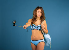 Pretty tourist girl with action camera Stock Images