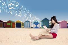 Pretty tourist using tablet at beach Stock Photos