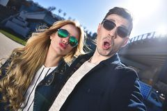 Pretty tourists make funny photos for travel blog in Europe. stock photo