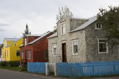 Pretty traditional colorful houses in Akureyri, Iceland. Pretty traditional colorful houses covered in stone tiles or corrugated iron in the old part of Akureyri royalty free stock image