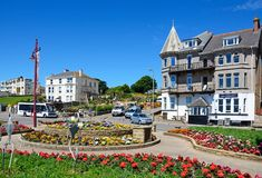 Pretty traffic island,Seaton. Pretty flowerbeds on a traffic island with town buildings to the rear, Seaton, Devon, England, UK, Western Europe Royalty Free Stock Image