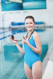 Pretty trainer blowing whistle and looking at stopwatch Stock Image