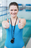 Pretty trainer with thumbs up Royalty Free Stock Photo