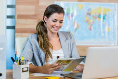 Pretty travel agent reading magazine. In the office Stock Photos